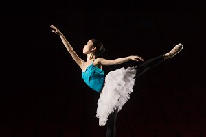 One ballerina practicing on stage