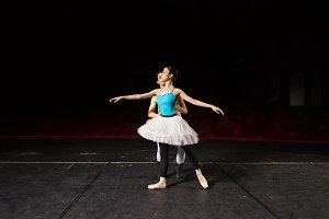 Ballet male holding ballerina waist