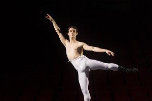 Male ballet dancer practicing leg