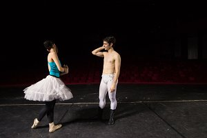 Ballet dance couple discussing stage