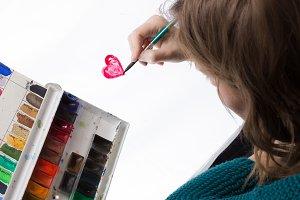 Artist painting heart shape