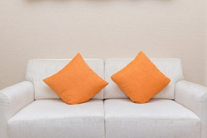 pillows on casual sofa in room