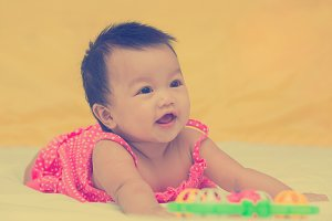Portrait of cute baby smiling girl