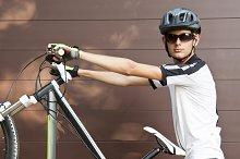 mountain biker with bike outdoors