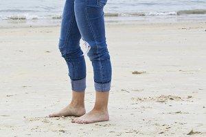 Elegant step on a sandy  beach