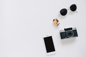 Creative flat lay with film camera