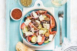 Greek salad with glass of wine