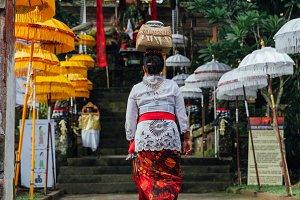 Woman carrying ceremonial box on her head, Ubud, Bali