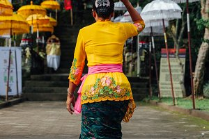 Woman carrying ceremonial box on her head, Ubud, Bali