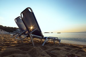 beach chairs on the shore