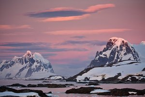 Snow-capped mountains in sunset