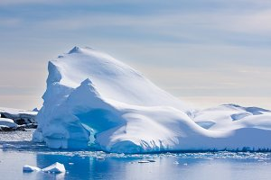 Antarctic iceberg covered with snow