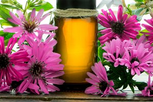 Essential oil, and small pink flower