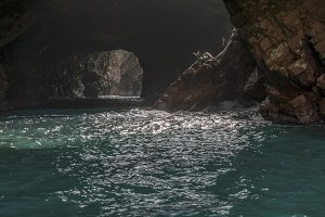 Sunlit caves Islas Ballestas, Peru
