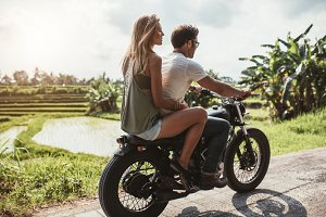 Man riding motorcycle with a woman