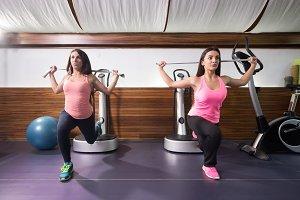 women exercise one leg lunge band