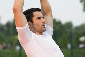 muscular man suspension training arm
