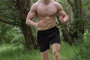 man shirtless fit running forest