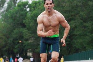 muscular man sprinter runner fast