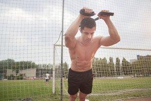 muscular man suspension training