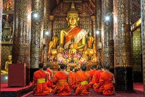 Praying Monks at Wat Xieng Thong