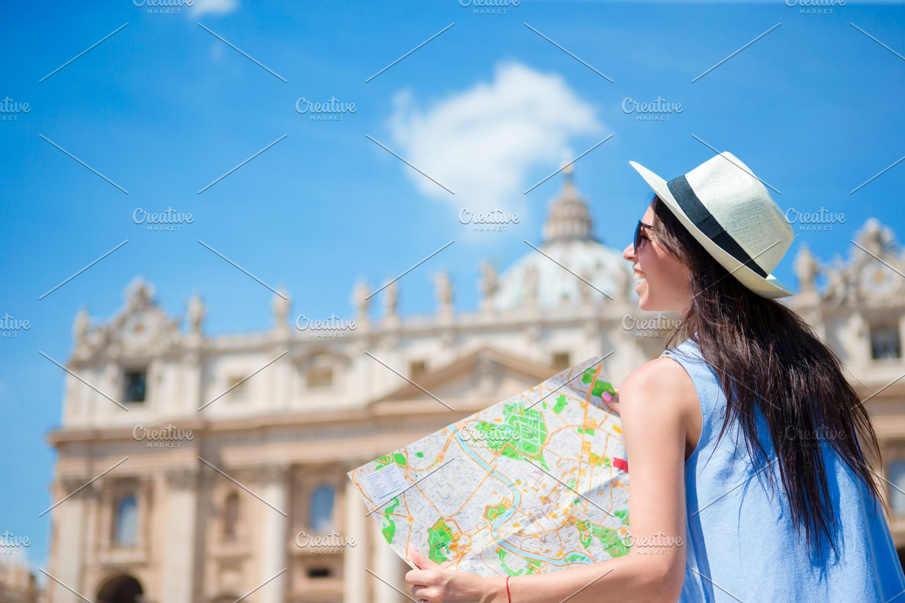 Happy young woman with city map in Vatican city and St  Peter's Basilica  church, Rome, Italy  Travel tourist woman with map outdoors during holidays