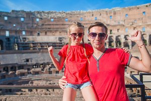 Young father and little girl in Coliseum, Rome, Italy. Family portrait at famous places in Europe