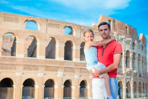 Young father and little girl background Colosseum, Rome, Italy. Family portrait at famous places in Europe