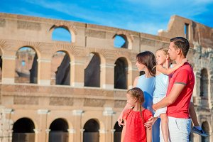 Happy family enjoy their vacation on Colosseum background. Italian european vacation together in Rome