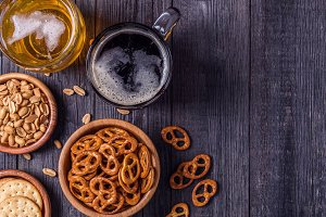 Beer with pretzels, crackers, nuts
