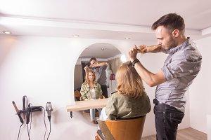 hairdresser combing hair woman