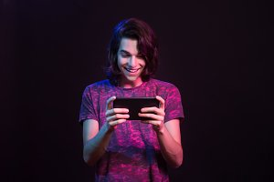 Cute young man happy using tablet