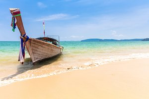 Traditional long-tail boat on beach, Krabi, Thailand