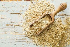 Oatmeal on rustic wood background
