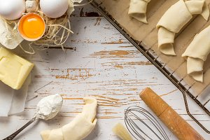 Baking croissants on rustic wood background
