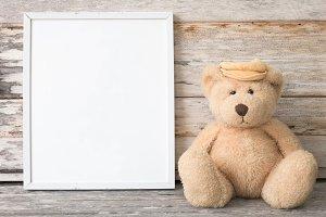 frame and teddy bear