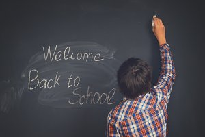 Boy and back to school black board
