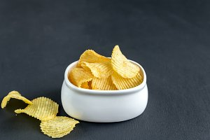 Potato chips in the glass bowl