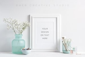 White Frame, Turquoise Desk Accents