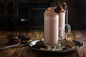 Chocolate cookie milkshake in tall mugs