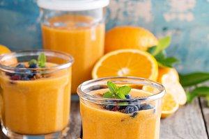 Orange and mango smoothie with granola