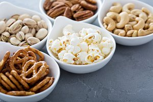 Variety of healthy snacks in white bowls