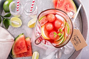 Watermelon drink with lime in a pitcher