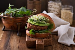 Grilled vegan bean burger with greens