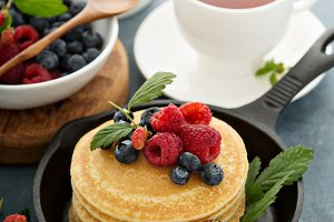 Fluffy buttermilk pancakes with fresh berries