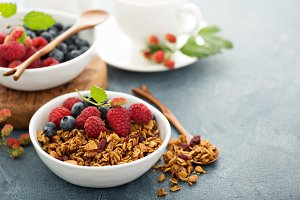 Granola and berries with coffee