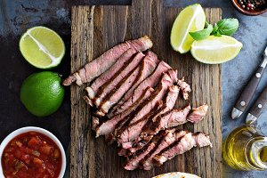 Cooking steak tacos with sliced meet
