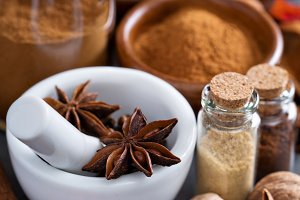 Pumpkin pie spice in a glass jar with ingredients