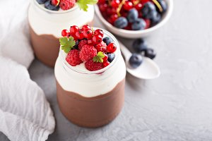 Chocolate pudding with cream and fresh berries
