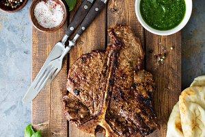 T-bone steak with chimichurri sauce